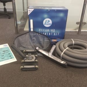 Image of contents of poolrite cleaning kit showing pool hose, vacuum head, wall brush, leaf rake and CPR chart,