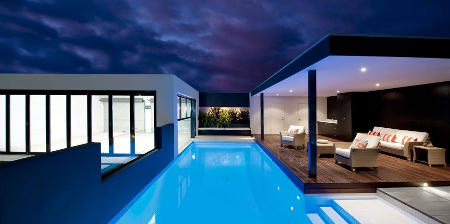Modern pool with undercover deck